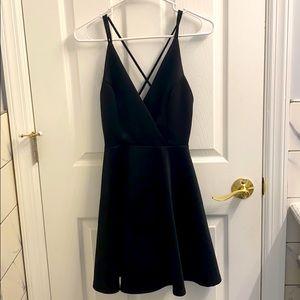 Open back, black strapped dress